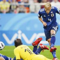 Keisuke Honda scores during Japan's match against Senegal during the 2018 World Cup in Yekaterinburg, Russia, on June 25. | KYODO