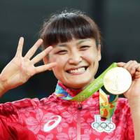 Kaori Icho is seen after winning the women's 58-kg Olympic wrestling title for the fourth time in August 2016 at the Rio Games. | KYODO