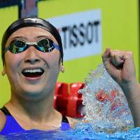 Rikako Ikee celebrates after winning the final of the women's 100-meter freestyle at the Asian Games in Jakarta on Monday. | AFP-JIJI