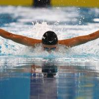 Rikako Ikee competes in a women's 100-meter butterfly heat on Tuesday in Jakarta. Ikee won the event, giving her four gold medals at the Asian Games.