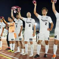 Andres Iniesta (8) and his Vissel Kobe teammates celebrate after a 2-0 win at Shonan Bellmare on Sunday. | KYODO
