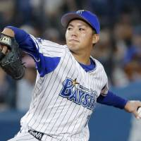 BayStars rookie Katsuki Azuma fires a pitch in Thursday's game against the Giants at Yokohama Stadium. Yokohama beat Yomiuri 6-0. | KYODO