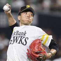 Hawks hurler Kodai Senga delivers a pitch in Friday's game against the Lions at Yafuoku Dome. Senga picked up his 10th win of the season in Fukuoka SoftBank's 3-2 victory over Seibu. | KYODO