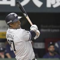 Yurisbel Gracial hits a grand slam in the 12th inning of the Hawks' 12-8 win over the Lions on Sunday at Yafuoku Dome in Fukuoka. | KYODO