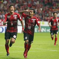 Consadole Sapporo's Chanathip Songkrasin (right) celebrates with Ken Tokura after scoring against FC Tokyo on Sunday in Sapporo. | KYODO