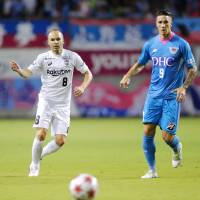 Sagan Tosu's Fernando Torres (right) and Vissel Kobe's Andres Iniesta compete during their match on Wednesday. | KYODO
