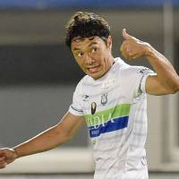 Shonan Bellmare's Tsukasa Umesaki celebrates after scoring a 32nd-minute goal against V-Varen Nagasaki on Friday night. Bellmare beat the hosts 3-1. | KYODO