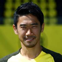 Borussia Dortmund's Shinji Kagawa is seen during a team photo session on Aug. 10 in Dortmund, Germany. | REUTERS