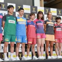 Japan's top players that will compete in the T.League pose for photos in Tokyo on Thursday. The newly launched pro table tennis circuit will kick off its inaugural season on Oct. 24 at Ryogoku Kokugikan. | KAZNAGATSUKA