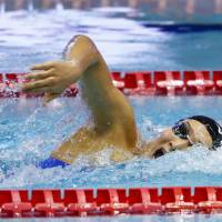 Rikako Ikee sets a national record in the women's 200-meter freestyle final on Thursday at the Pan Pacific Championships, claiming the silver medal in 1 minute, 54.85 seconds. | KYODO