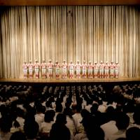 The team stands on stage during a pep rally before leaving for Koshien. | LANCE HENDERSTEIN