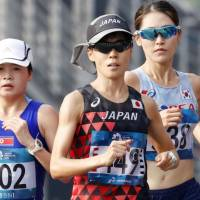 Keiko Nogami (center) competes during the women's marathon at the Asian Games on Sunday in Jakarta. Nogami earned a silver medal in the event. | KYODO