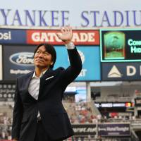 Former New York Yankees outfielder Hideki Matsui waves to fans during a pregame ceremony commemorating his induction into the Japanese Hall of Fame on Monday at Yankee Stadium. | ANDY MARLIN / USA TODAY / VIA REUTERS