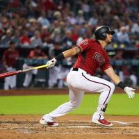 Corbin, big bats propel D-Backs