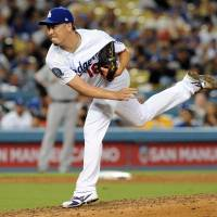 Los Angeles reliever Kenta Maeda pitches during the Dodgers' game against the Giants on Tuesday. | USA TODAY / VIA REUTERS
