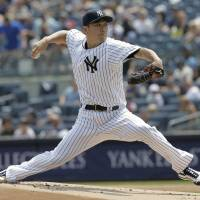 New York starter Masahiro Tanaka pitches against Tampa Bay in the first inning on Thursday. | AP