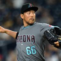 Arizona reliever Yoshihisa Hirano pitches against San Diego in the sixth inning on Friday night. | USA TODAY / VIA REUTERS