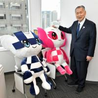 Yoshiro Mori, president of the Tokyo Organising Committee of the Olympic and Paralympic Games, is seen with Tokyo 2020 official mascots Miraitowa (left) and Someity, earlier this month at his office in Toranomon Hills. | YOSHIAKI MIURA