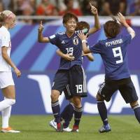 Japan's Riko Ueki (center) celebrates after scoring the opening goal against England in the semifinals of the FIFA U-20 Women's World Cup on Monday. | KYODO