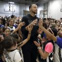 Golden State Warriors star Stephen Curry greets participants at his girls basketball camp after taking a group photo earlier this week in Walnut Creek, California.