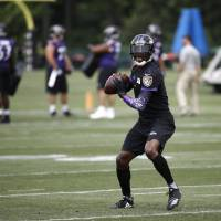 Baltimore quarterback Robert Griffin III prepares to throw a pass during the team's training camp in Owings Mills, Maryland, last month. | AP