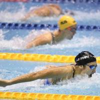 Rikako Ikee leads the pack in the women's 100-meter butterfly final at the Pan Pacific Swimming Championships on Saturday at Tokyo Tatsumi International Swimming Center. Ikee won the race in 56.08 seconds, a national record. | KYODO