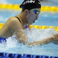 Yui Ohashi swims in the women's 200-meter individual medley final on Saturday. Ohashi triumphed in 2 minutes, 8.16 seconds. | AP