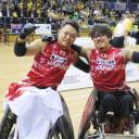 Japan wheelchair rugby national team captain  Yukinobu Ike (left) and teammate Daisuke Ikezaki celebrate the team's 2018 Wheelchair Rugby World Championship victory over Australia on Friday in Sydney.