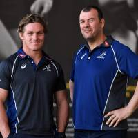 Australia captain Michael Hooper (left) poses with coach Michael Cheika after a news conference on Friday in Sydney. | AFP-JIJI