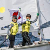 Ai Yoshida and Miho Yoshioka celebrate after winning the gold medal in the women's 470 class at the Sailing World Championships in Aarhus, Denmark, on Thursday. | KYODO