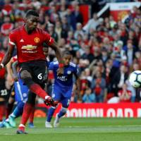Manchester United's Paul Pogba scores against Leicester City on a penalty kick on Friday in the Premier League opener at Old Trafford. | REUTERS