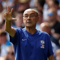 Chelsea manager Maurizio Sarri gives instructions during his team's match against Huddersfield on Saturday. | REUTERS