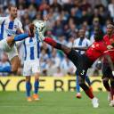 Manchester United's Eric Bailly (right) and Brighton's Glenn Murray vie for the ball during their match on Sunday in Brighton, England. Brighton won 3-2.