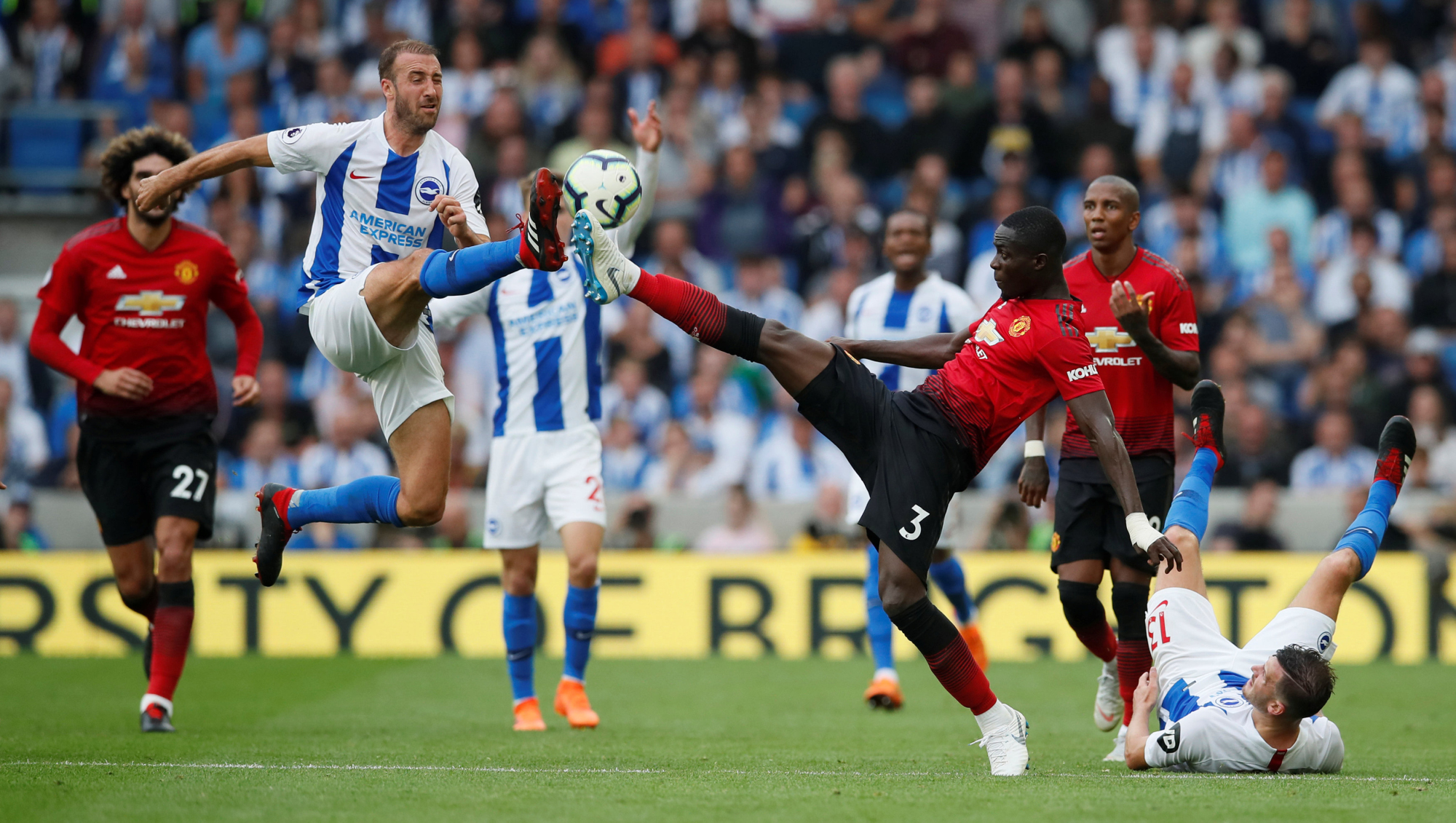 Manchester United's Eric Bailly (right) and Brighton's Glenn Murray vie for the ball during their match on Sunday in Brighton, England. Brighton won 3-2. | REUTERS