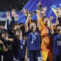 Japan players celebrate following their 3-1 victory over Spain in the final of the Women's Under-20 World Cup on Friday night in Vannes, France. KYODO