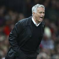 Manchester United manager Jose Mourinho shouts instructions during Monday night's Premier League match against Tottenham Hotspur at Old Trafford. | AP