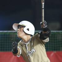 Japan's Yu Yamamoto hits a second-inning grand slam against Puerto Rico in a Women's Softball World Championship game on Friday in Chiba. Japan beat Puerto Rico 7-0. | KYODO