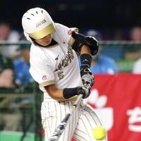 Japan's Yu Yamamoto belts a two-run homer in the first inning against the United States in a Women's Softball World Championship match on Saturday night at Zozo Marine Stadium. The United States won 4-3 in eight innings. | KYODO