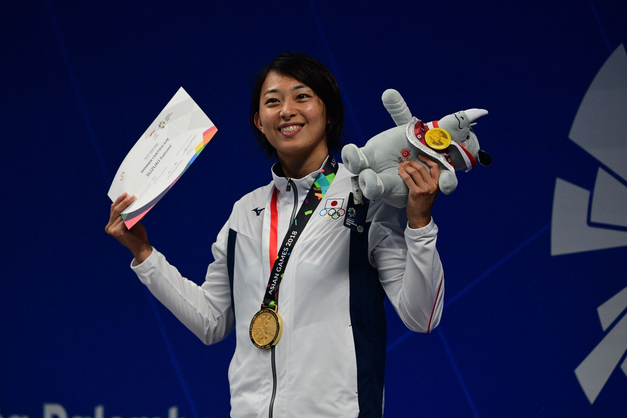 Satomi Suzuki, seen celebrating after winning the women's 50-meter breaststroke final on Thursday at the Asian Games in Jakarta, collected three golds at the marquee meet. | AFP-JIJI