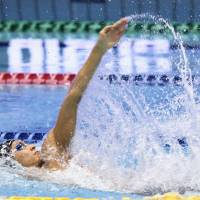 Ryosuke Irie competes in the men's 100-meter backstroke final. He placed second in 52.78 seconds. | KYODO