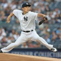 New York's Masahiro Tanaka pitches during the Yankees' 6-3 win over the Orioles on Tuesday.   USA TODAY / VIA REUTERS