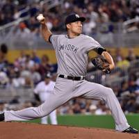 New York's Masahiro Tanaka pitches during the Yankees' 2-1 win over the Marlins in Miami on Tuesday. | USA TODAY / VIA REUTERS