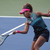 Naomi Osaka plays a shot during her first-round win over American Bernarda Pera at the Citi Open in Washington on Tuesday. | AP