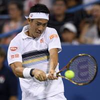 Kei Nishikori plays a shot from American Donald Young in their second-round match at the Citi Open in Washington on Wednesday night. | AP