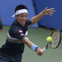Kei Nishikori plays a shot from Germany's Alexander Zverev in their quarterfinal match at the Citi Open on Friday. | AP