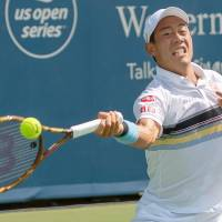 Kei Nishikori plays a shot from Andrey Rublev in their first-round match at the Western & Southern Open on Monday. | KYODO
