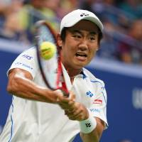 Yoshihito Nishioka plays a shot during his first-round match against Roger Federer at the U.S. Open in New York on Tuesday. | AFP-JIJI