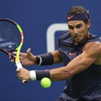 Rafael Nadal moves into U.S. Open third round; Andy Murray ousted