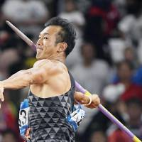 Decathlete Keisuke Ushiro throws the javelin on Sunday at the Asian Games in Jakarta. Ushiro repeated as champion at the quadrennial competition. | KYODO