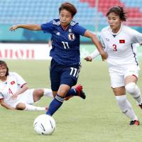 Japan's Mina Tanaka controls the ball in an Asian Games match against Vietnam on Tuesday in Palembang, Indonesia. Japan won 7-0, with Tanaka scoring two goals. | KYODO